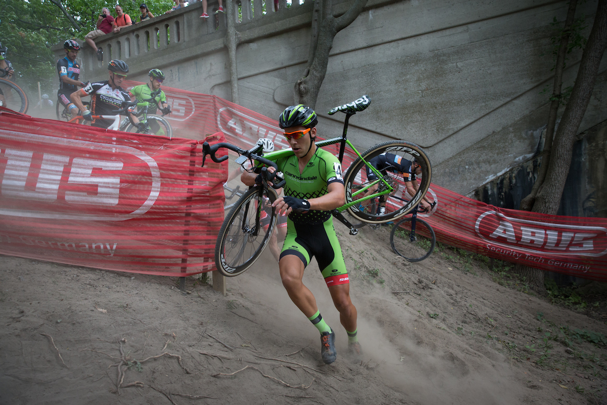 Curtis White of Cannondale p/b Cyclocrossworld.com shoulders his bike in the steep and dusty terrain.